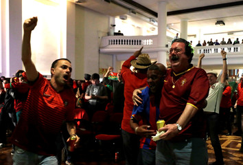 Portuguese descendants celebrate the first goal during FIFA World Cup in Sao Paulo