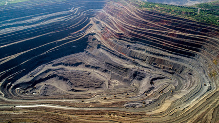 Aerial view of opencast mining quarry with lots of machinery at work. Wall mural