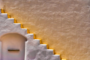 Yellow wall  with white stairs