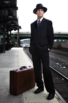 Man waiting for a train in 1940s attire