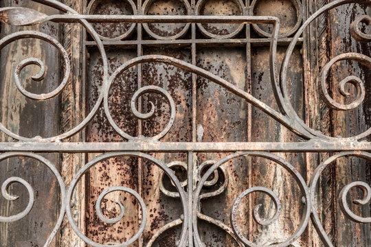 Ornate Rusted wrought iron cemetery gate and door. What the Gate to Hell might look like I
