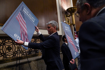 A man hangs a sign at the Executive Branch Job Fair hosted by the Conservative Partnership Institute at the Dirksen Senate Office Building in Washington
