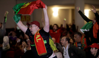 Portuguese descendants celebrate the third goal during FIFA World Cup in Sao Paulo