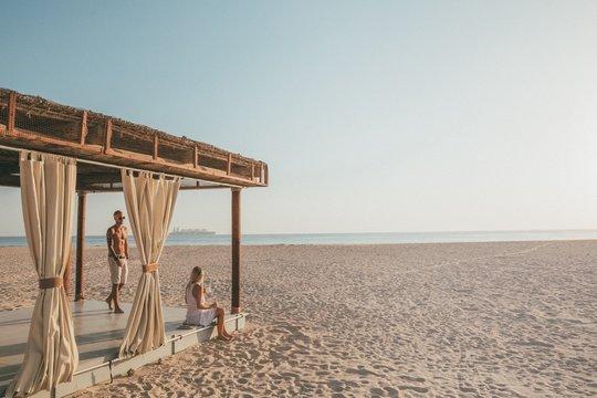 Romantic couple having fun on the beach in Sir bani Yas