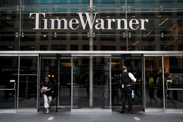 A worker cleans the entrance of Time Warner Center in the Manhattan borough of New York City, New York