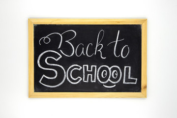 Back to school chalk lettering on blackboard. White chalk Back to school inscription on chalkboard