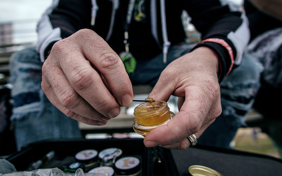 A Man Holding Cannabis Extract