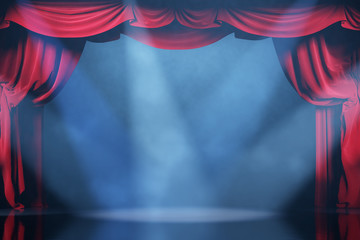 Volume light and smoke on the theater stage with red velvet curtains.