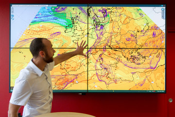 Weather maps are seen during a visit at the EDF–DTG division for weather forecasts in Grenoble