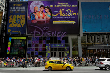 People walk by Disney store at Times Square in the Manhattan borough of New York City, New York