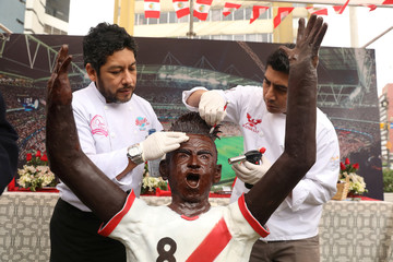 Cook prepares the chocolate figure of a Peruvian soccer player Christian Cueva at a stand at a park in Miraflores district of Lima