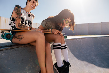 Friends laughing and enjoying at the skate park