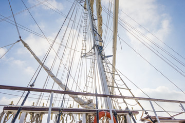 Rigging of a tall ship in a port in sunlight in spring
