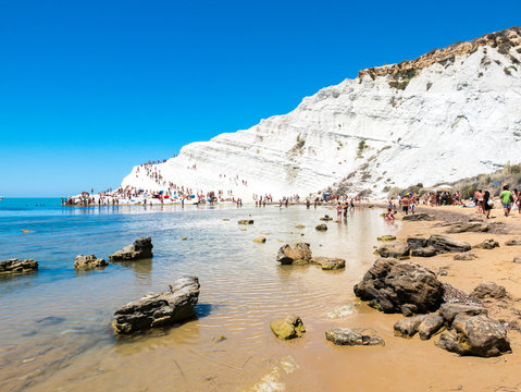 """""""Stairs of the Turks"""" (italian: Scala dei Turchi), beautiful white rocky cliff made of marl, facing on the Mediterranean Sea, seen from the sandy beach with shallow water - Realmonte, Agrigento Sicily"""