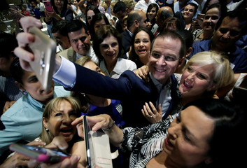 Ricardo Anaya, presidential candidate for the National Action Party (PAN), and who heads a right-left coalition,  takes selfies with supporters in Monterrey
