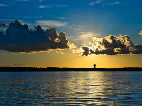 Dramatic clouds and sunset over lake in Bemidji Minnesota