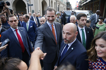Spain's King Felipe VI shakes hands with people as he leaves Jackson Square in New Orleans