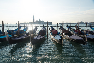 Gondola in Venice Italy during a bright sunny day over the waters in the Mediterranean ocean