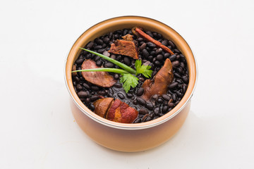 Mini Brazilian feijoada ready for consumption on white background