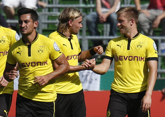 Borussia Dortmund's Schmelzer and team mate Blaszczykowski celebrate after scoring against FC Oberneuland during German DFB Cup soccer match in Bremen