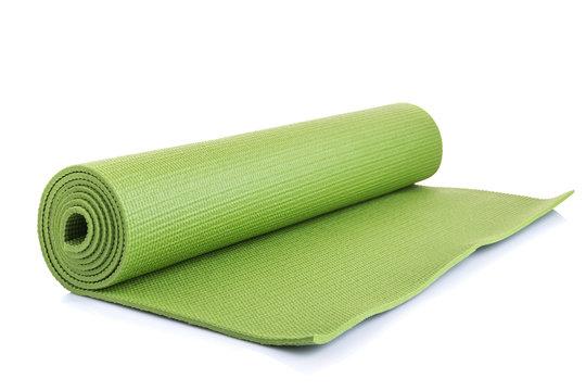 New green soft Yoga mat. Studio shot isolated on white