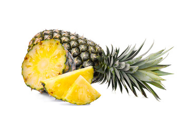 whole with slice ripe pineapple isolated on white background