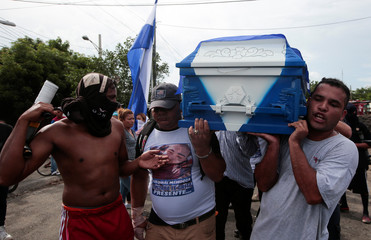 Demonstrators take part in funeral service of Agustin Ezequiel Mendoza, who was shot in recent protests against Nicaraguan President Daniel Ortega's government in Tipitapa, Nicaragua