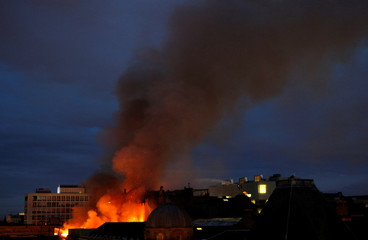 Firefighters attend to a blaze at the Mackintosh Building at the Glasgow School of Art for the second time in four years, Glasgow, Scotland, Britain