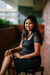Corporate portrait head shot of a confident and attractive Indian Asian business woman.