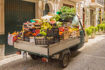 Small truck filled with vegetables and fresh fruits