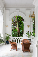 Old historic courtyard with green palms in Singapore