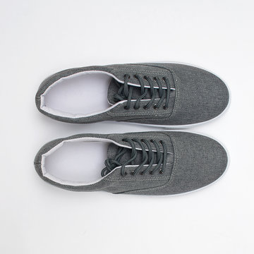 gray sneakers on a white background