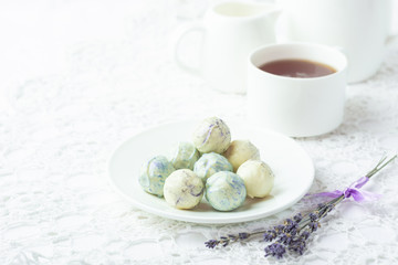 Round homemade sweets of white chocolate on the kitchen table. Morning tea. Copy space.