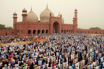 People attend Eid al-Fitr prayers at the Badshahi Mosque in Lahore