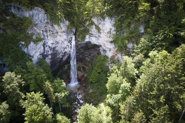 drone flight over giant big waterfall called Wildensteiner waterfall in austria