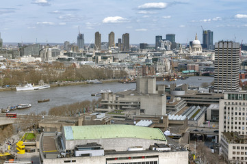 Aerial view of cityscape and skyline of London with the Thames, a major river that flows through southern England, most notably through London, United Kingdom