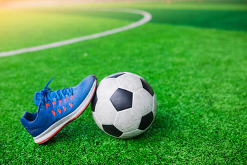 Football and Sports shoes on artificial turf.
