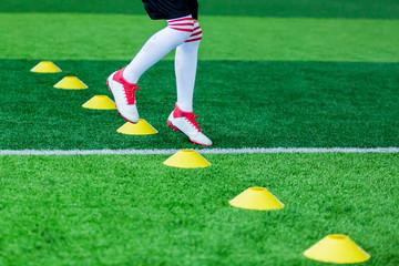 Kid soccer Jogging between marker cones