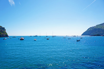 Boats and yacht on the sea in a sunny bright day in Italy