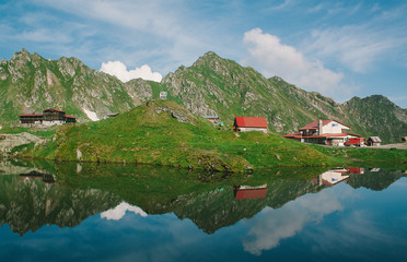 Balea glacier lake in Transfagarasan pass at summer. Crossing Carpathian mountains in Romania, Transfagarasan is one of the most spectacular mountain roads in the world