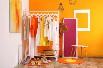 Stylish dressing room interior with clothes rack and mirror
