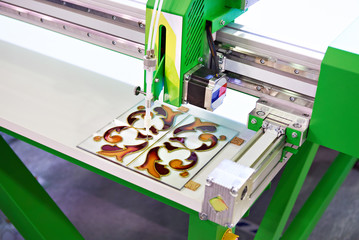Stained glass machine for applying decorative polymer