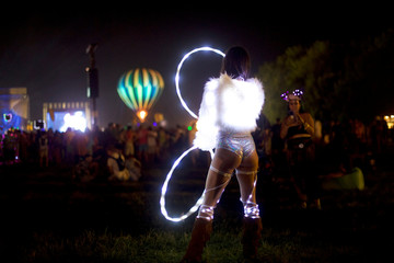 Lili Mitchell, 23, dances to Lil Xan on the second day of the Firefly Music Festival in Dover, Delaware