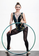 Woman with gymnastic ring. Woman train acrobatics with hula hoop in sportswear. Fitness and dieting of girl gymnast. Workout sports activities in gym of flexible girl. Sport success and health