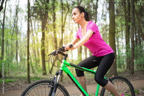 Happy Young Beautiful Woman Riding Sport Mountaine Bicycle