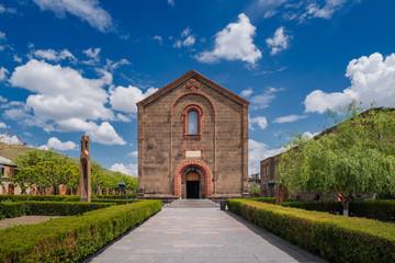 Central portal of the Church of St. Mesrop Mashtots in Oshakan village. Summer sunny day in Armenia.