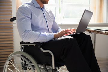 Disabled Businessman Using Laptop