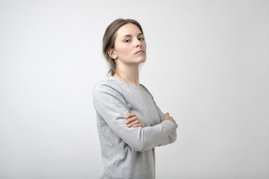 The young woman portrait with proud and arrogant emotions on face.