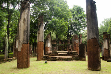 View landscape of buddha statue at Wat Phra Non in ancient building and ruins city of Kamphaeng Phet Historical Park