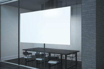 Contemporary meeting room with billboard